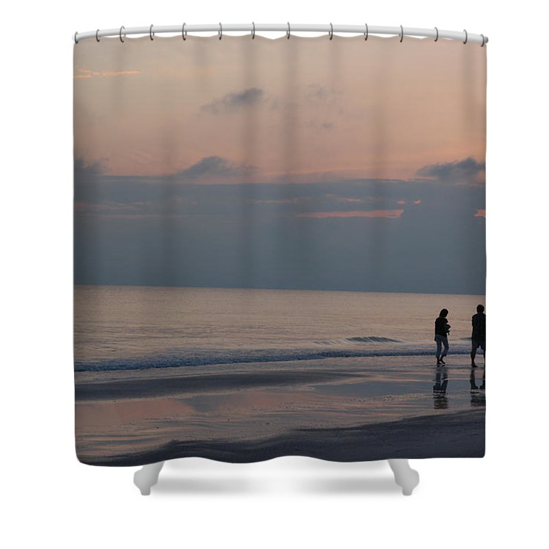 Holmes Beach Shower Curtain featuring the photograph People Enjoy A Walk On The Beach by Stacy Gold