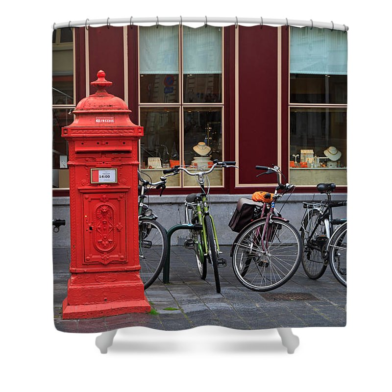 Postbox Shower Curtain featuring the photograph Postbox And Bicycles In Front Of The Diamond Museum In Bruges by Louise Heusinkveld