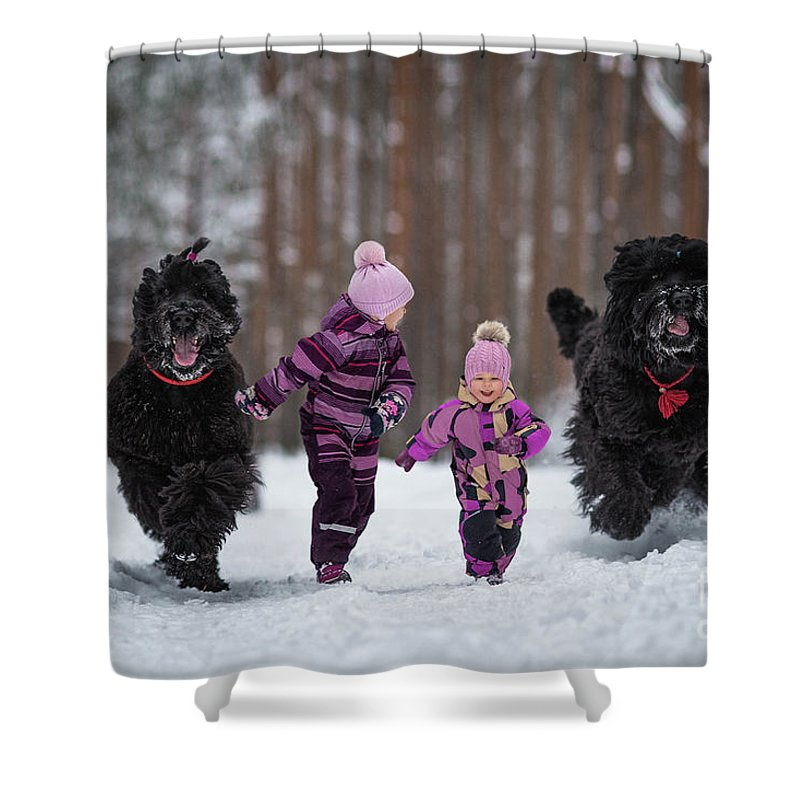 Black Russian Terriers Shower Curtain featuring the photograph Race You by Andy Seliverstoff