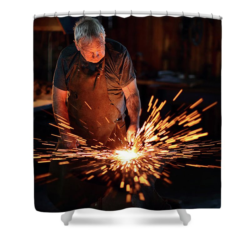 Blacksmith Shower Curtain featuring the photograph Sparks When Blacksmith Hit Hot Iron by Johan Swanepoel