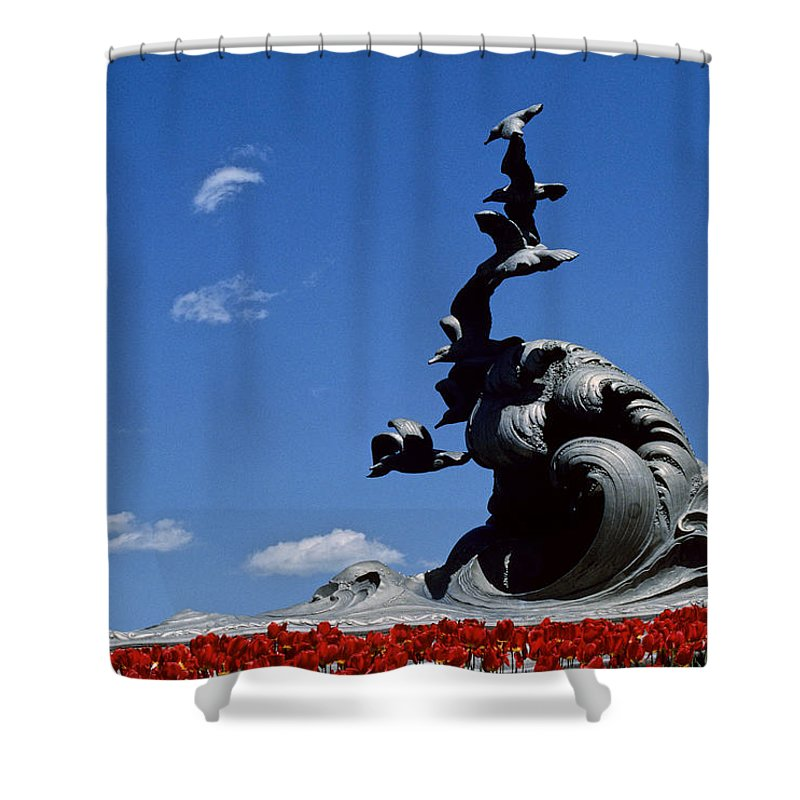 Statues Shower Curtain featuring the photograph Statue And Tulips Against A Clear Blue by Kenneth Garrett
