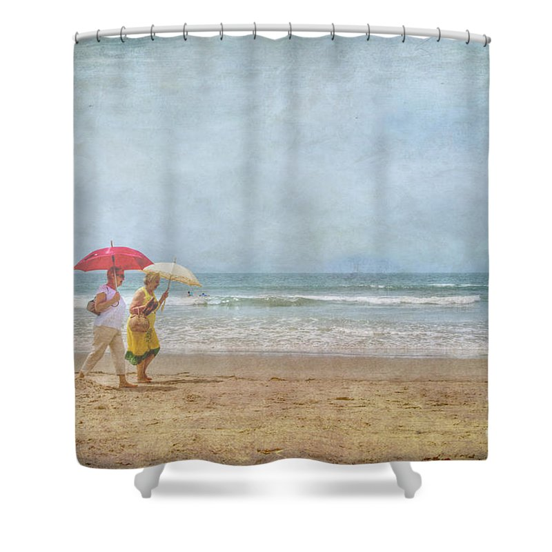 Two Elderly Women Strolling On Beach Shaded By Colorful Umbrellas Shower Curtain featuring the photograph Strolling On The Beach by David Zanzinger