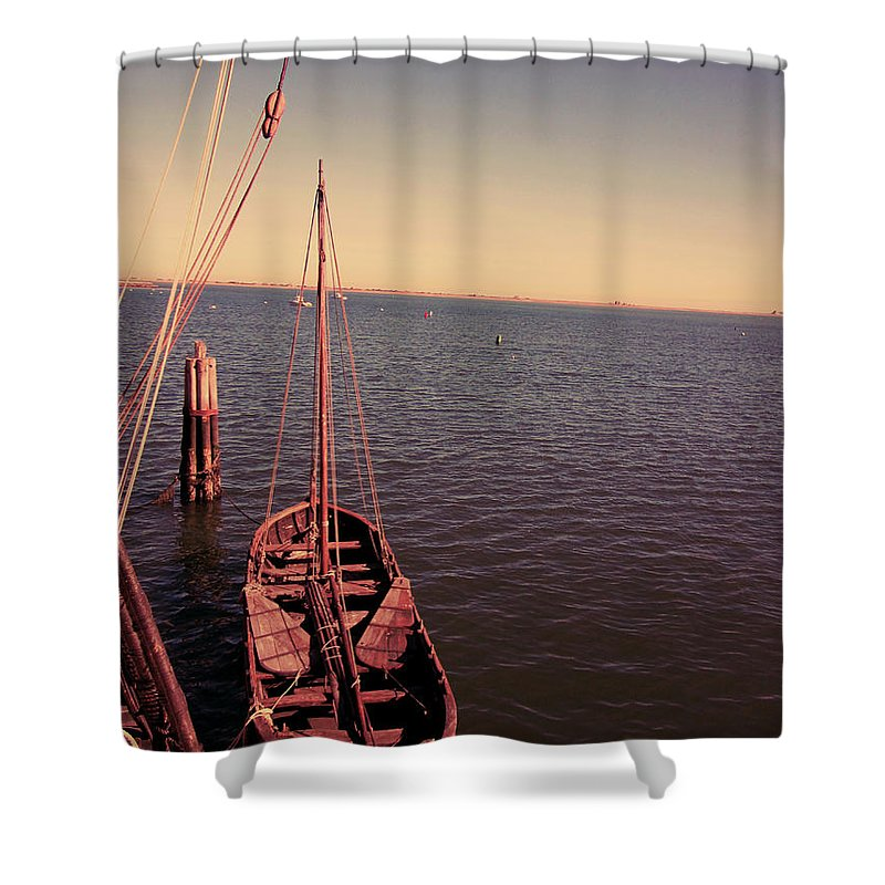 Wooden Boat Photographs Shower Curtain featuring the photograph The Old Wooden Boat by Lourry Legarde