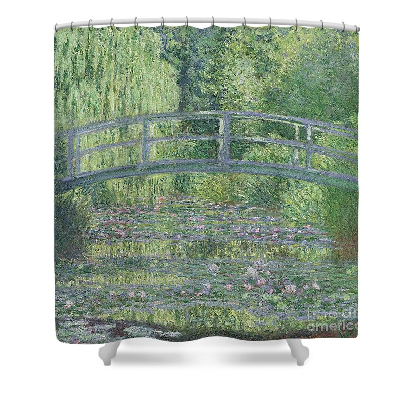 The Shower Curtain featuring the painting The Waterlily Pond by Claude Monet