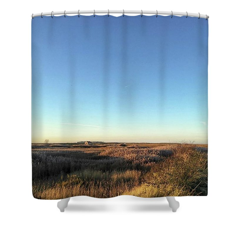 Natureonly Shower Curtain featuring the photograph Thornham Marsh Lit By The Setting Sun by John Edwards