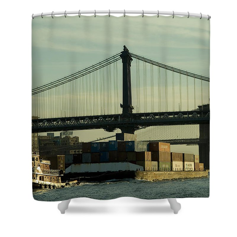 New York City Shower Curtain featuring the photograph Tugboat Pulling A Barge On The East by Todd Gipstein