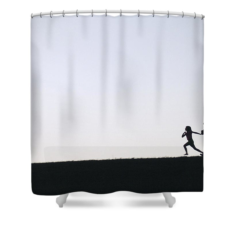 Two People Shower Curtain featuring the photograph Two Children Are Silhouetted by Joel Sartore