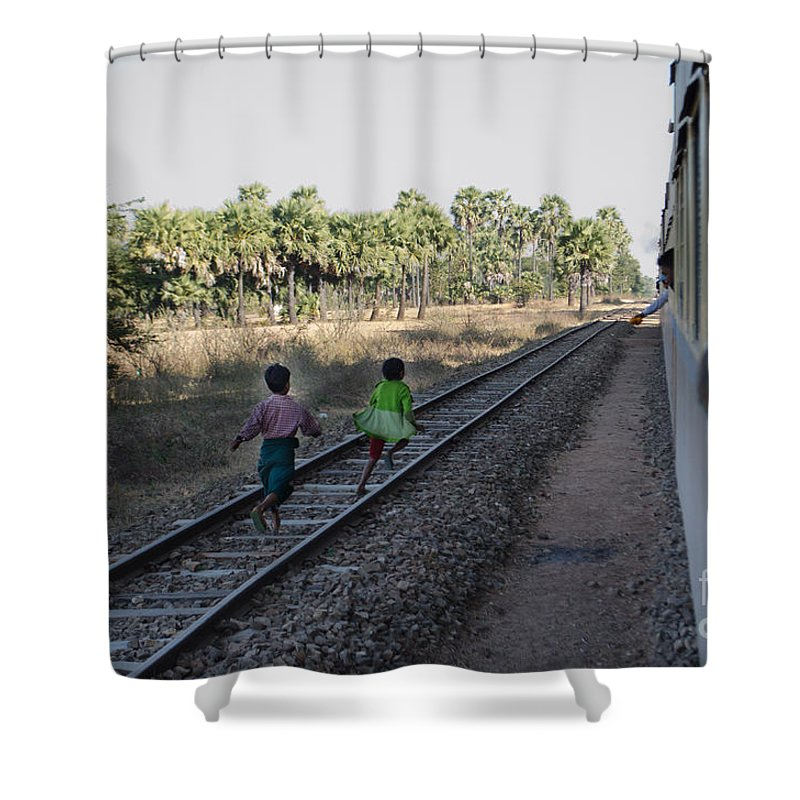Asia Shower Curtain featuring the photograph Two Kids Run Along And Follow Train In Burma by Jason Rosette