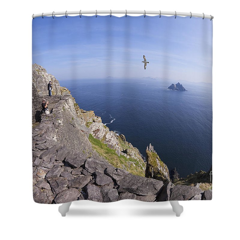 Visitors Shower Curtain featuring the photograph Visitors Admire Celtic Monastery, Skellig Michael, Looking To Little Skellig, County Kerry, Ireland by Peter Barritt