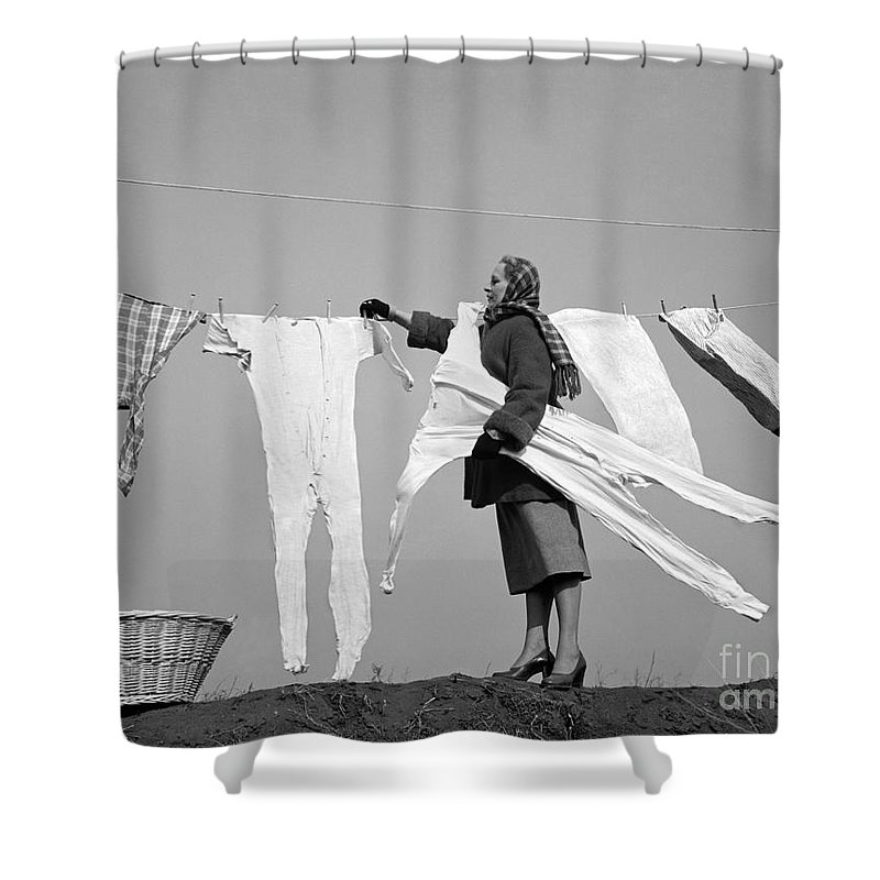 1940s Shower Curtain Featuring The Photograph Woman Removing Frozen Clothes By Debrocke ClassicStock
