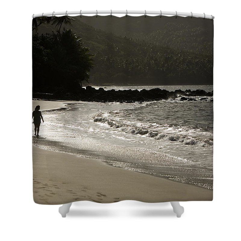 One Mid Adult Woman Shower Curtain featuring the photograph Woman Walking On A Deserted Beach by Tim Laman