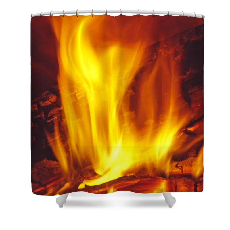 Fire Shower Curtain featuring the photograph Wood Stove - Blazing Log Fire by Steve Ohlsen