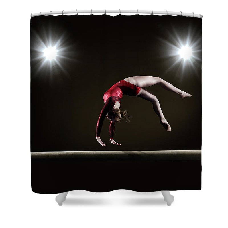 Expertise Shower Curtain featuring the photograph Female Gymnast On Balance Beam by Mike Harrington