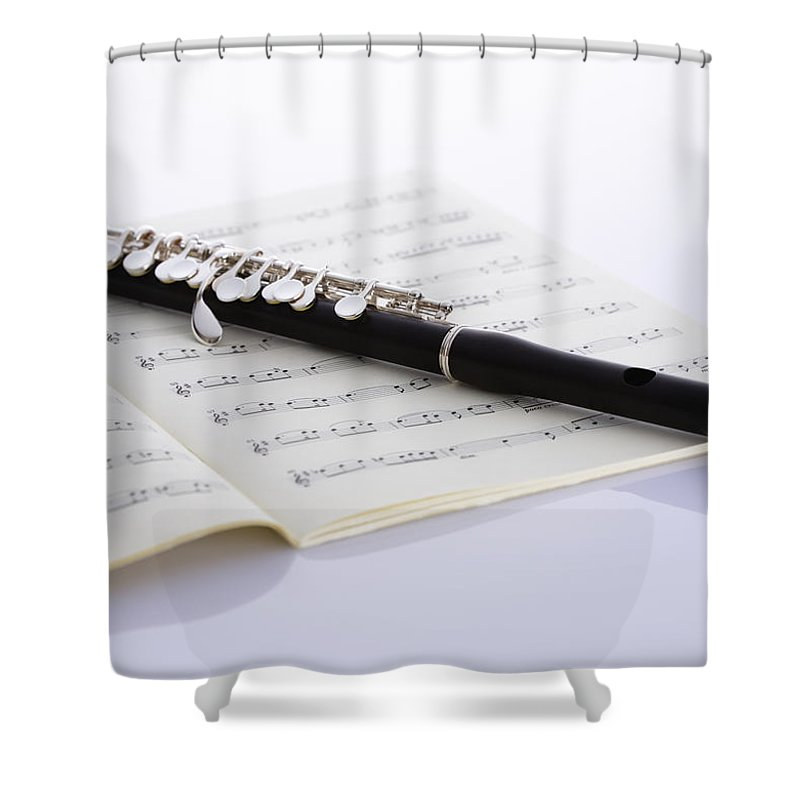 Sheet Music Shower Curtain featuring the photograph Piccolo On A Score by Imagenavi