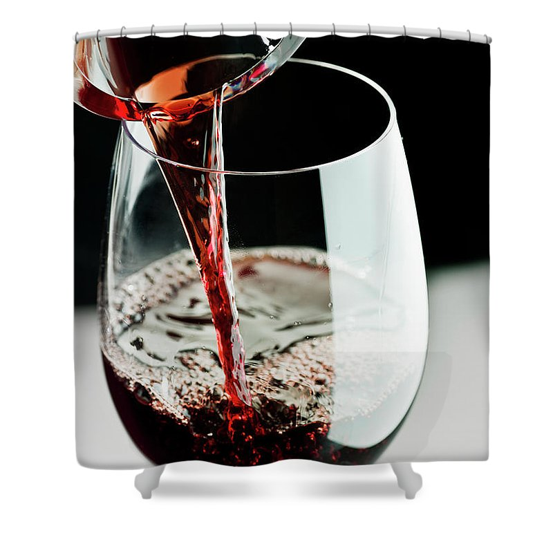 Alcohol Shower Curtain featuring the photograph Red Wine Being Poured In A Glass by Juanmonino