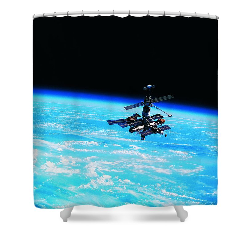 Alertness Shower Curtain featuring the photograph A Space Station Orbiting Above Earth by Stockbyte