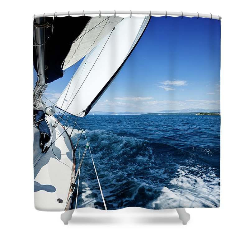 Curve Shower Curtain featuring the photograph Sailing In The Wind With Sailboat by Mbbirdy