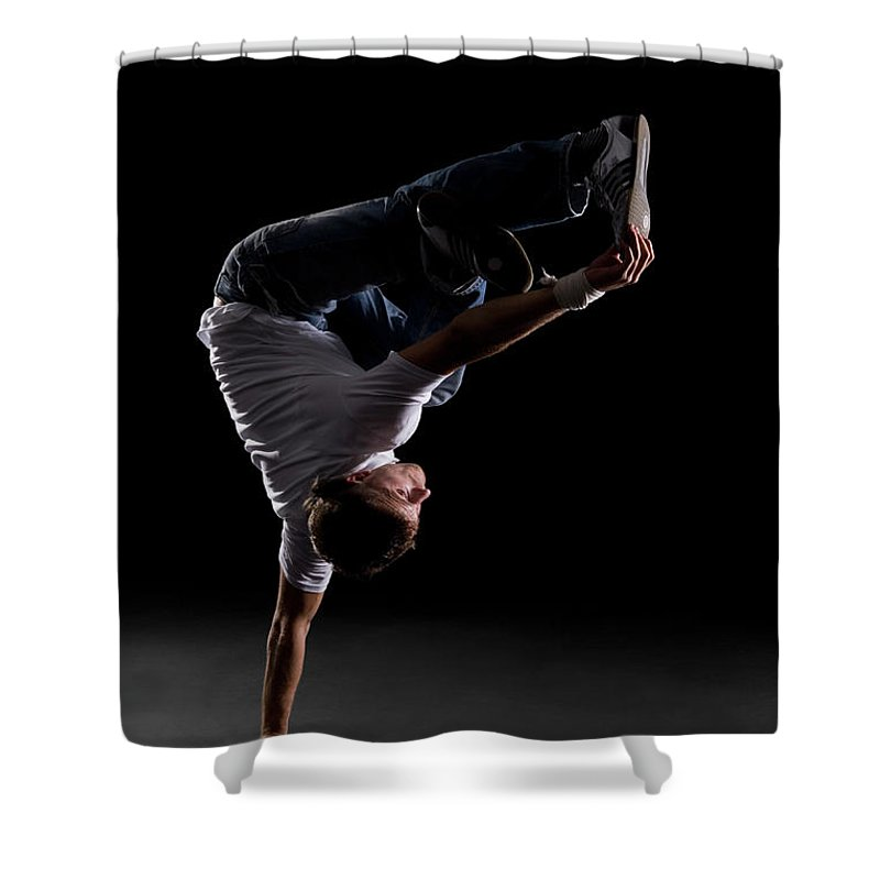 Expertise Shower Curtain featuring the photograph A B-boy Doing A Freeze Breakdance Move by Halfdark