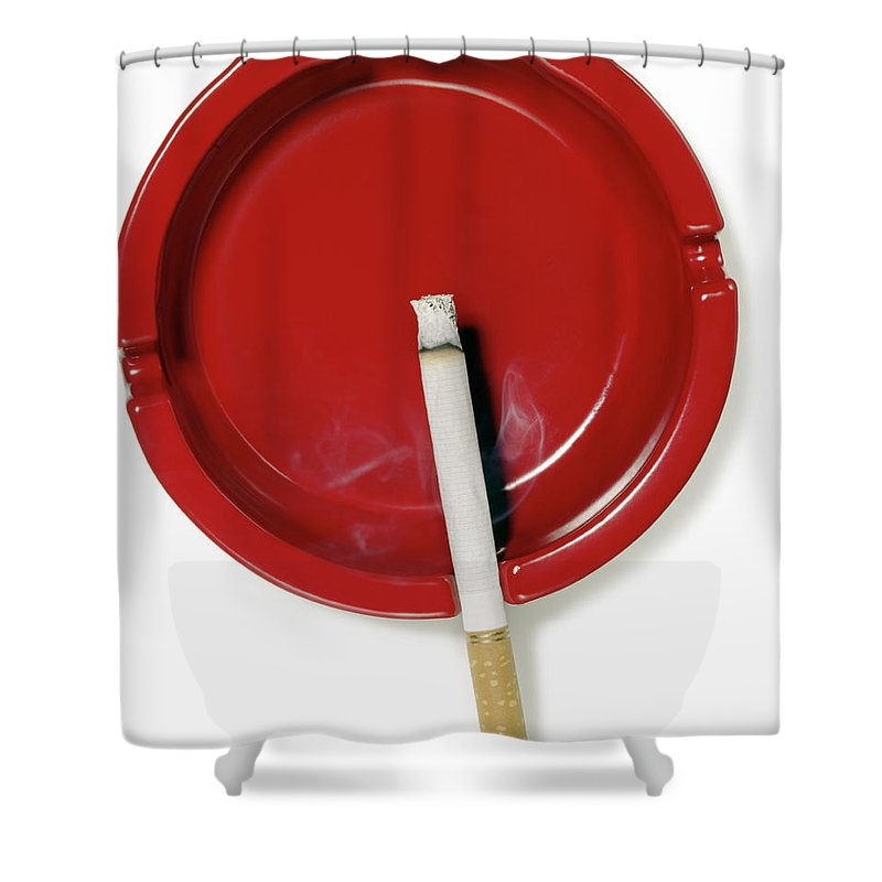 White Background Shower Curtain featuring the photograph A Red Ashtray With A Burning Cigarette by Steve Wisbauer