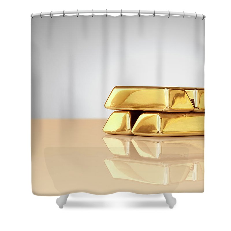 Four Objects Shower Curtain featuring the photograph A Stack Of Four Gold Ingots by Anthony Bradshaw