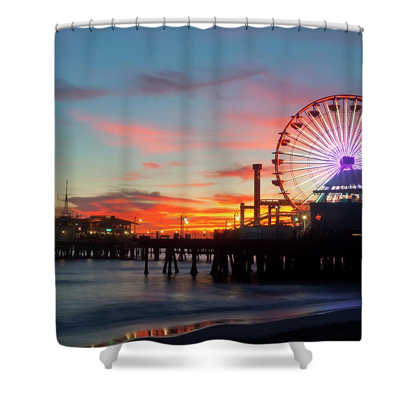 Scenics Shower Curtain featuring the photograph Amusement Park On Waterfront At Night by Blend Images/pete Saloutos