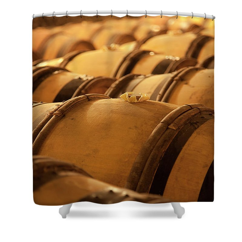 Fermenting Shower Curtain featuring the photograph An Old Wine Cellar Full Of Barrels by Brasil2