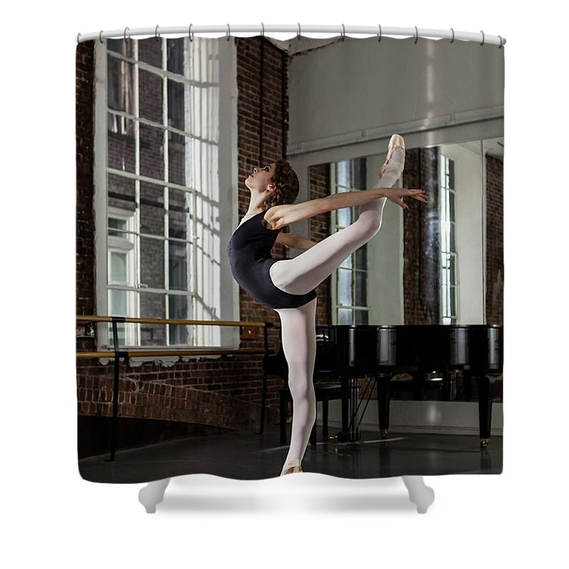 Ballet Dancer Shower Curtain featuring the photograph Ballerina Performing Attitude In Dance by Nisian Hughes
