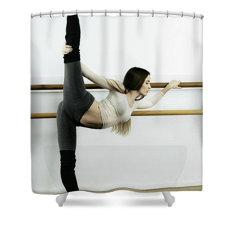 Ballet Dancer Shower Curtain featuring the photograph Ballet Dancer Stretching In Dance by Patrik Giardino