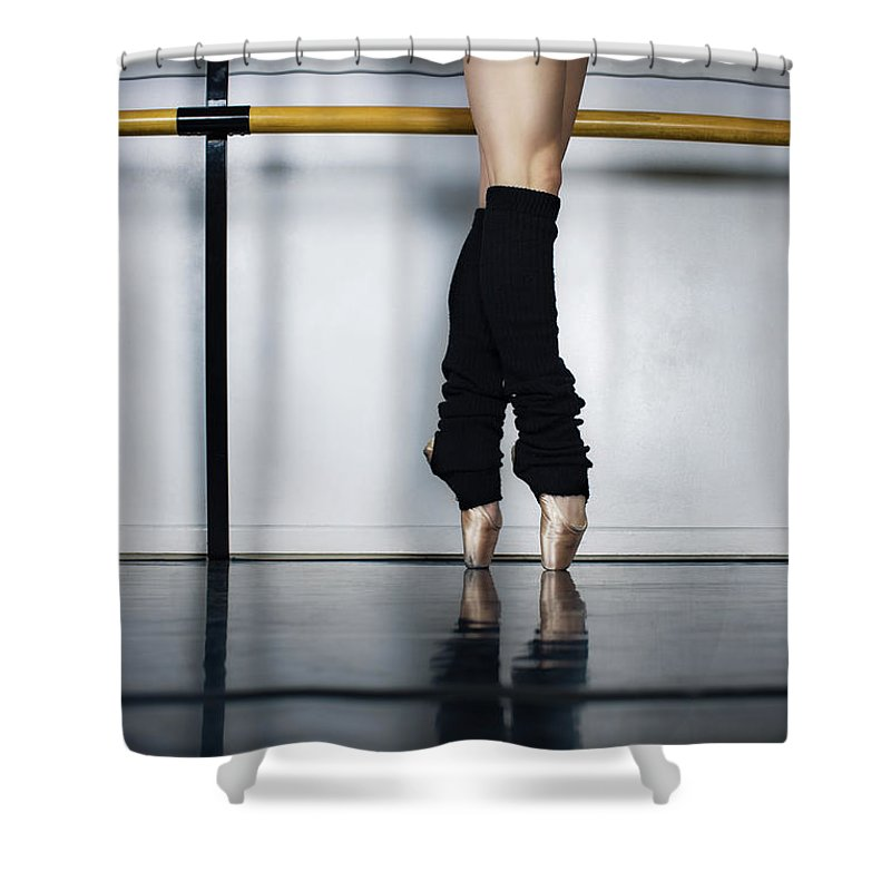 Ballet Dancer Shower Curtain featuring the photograph Ballet Holdiing Bar In Classic Pointe by Patrik Giardino
