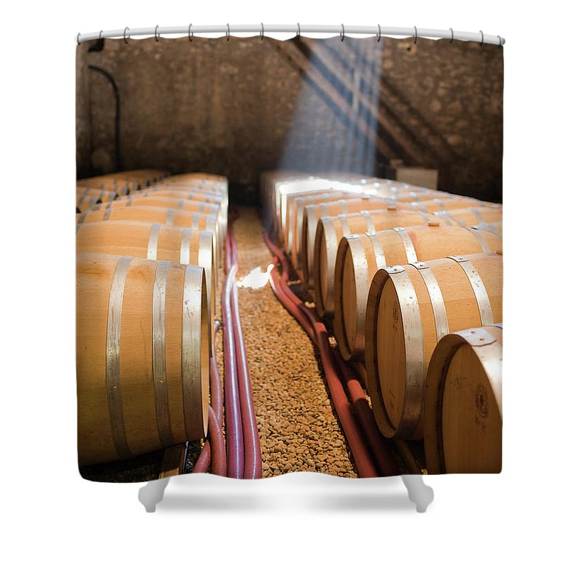 Alcohol Shower Curtain featuring the photograph Barrels In Wine Cellar by Johner Images
