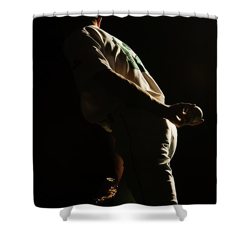 Three Quarter Length Shower Curtain featuring the photograph Baseball Pitcher Holding Ball Behind by Pm Images