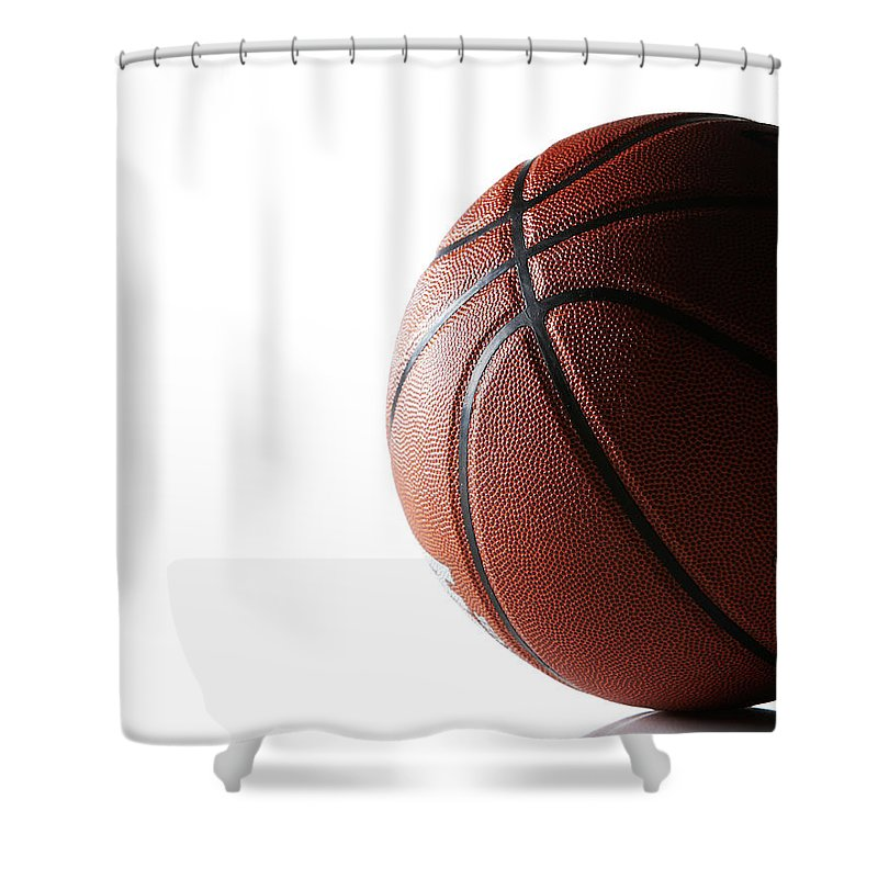 Recreational Pursuit Shower Curtain featuring the photograph Basketball On White Background by Thomas Northcut