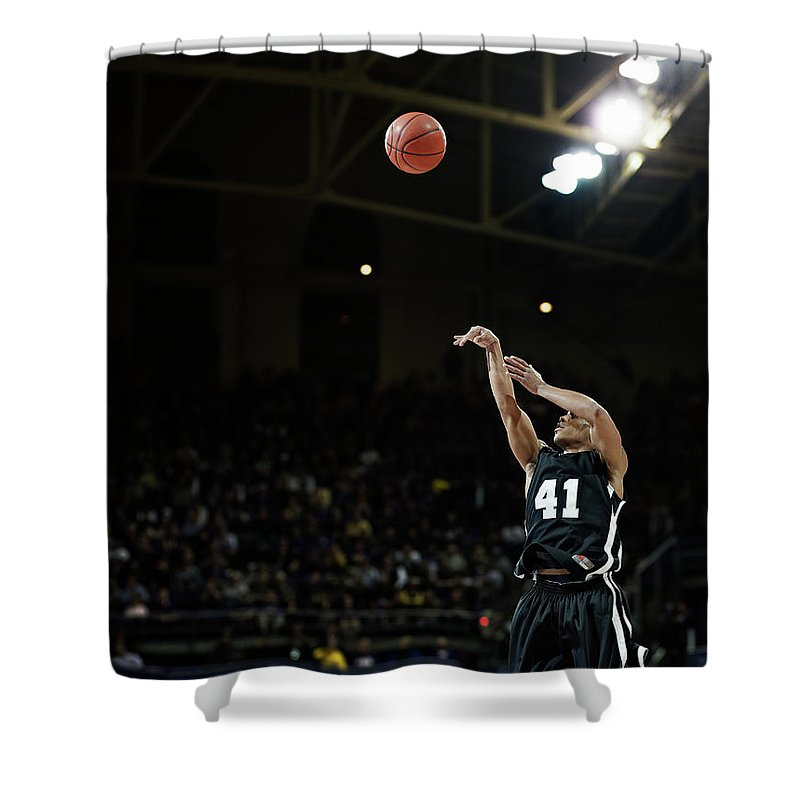 Expertise Shower Curtain featuring the photograph Basketball Player Shooting Jump Shot In by Thomas Barwick