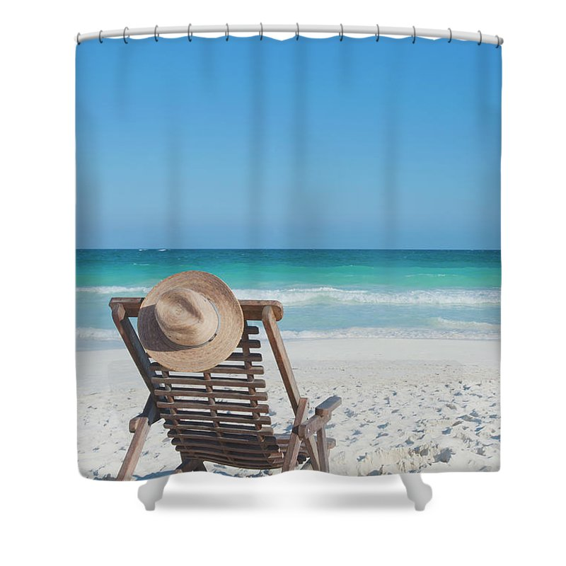 Scenics Shower Curtain featuring the photograph Beach Chair With A Hat On An Empty Beach by Sasha Weleber