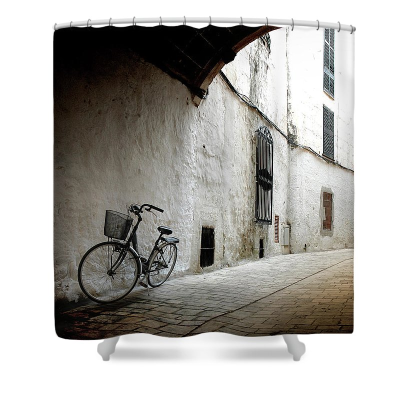 Tranquility Shower Curtain featuring the photograph Bicycle Leaning Wall by Antonio R. Ramos