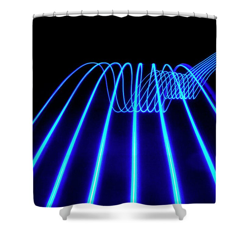 Laser Shower Curtain featuring the photograph Blue Abstract Coloured Lights Trails by John Rensten