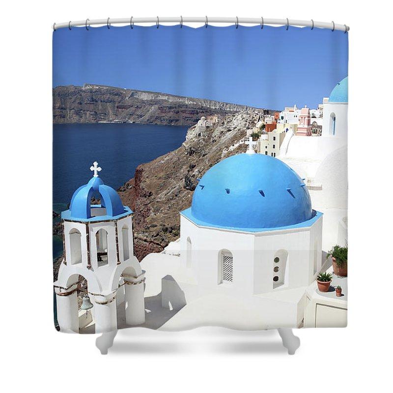 Greek Culture Shower Curtain featuring the photograph Blue Domes Of Santorini by Jurgar