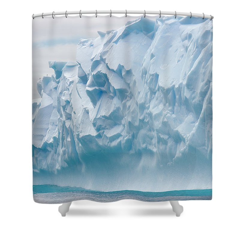 Scenics Shower Curtain featuring the photograph Blue Iceberg Carved By Waves Floats In by Eastcott Momatiuk