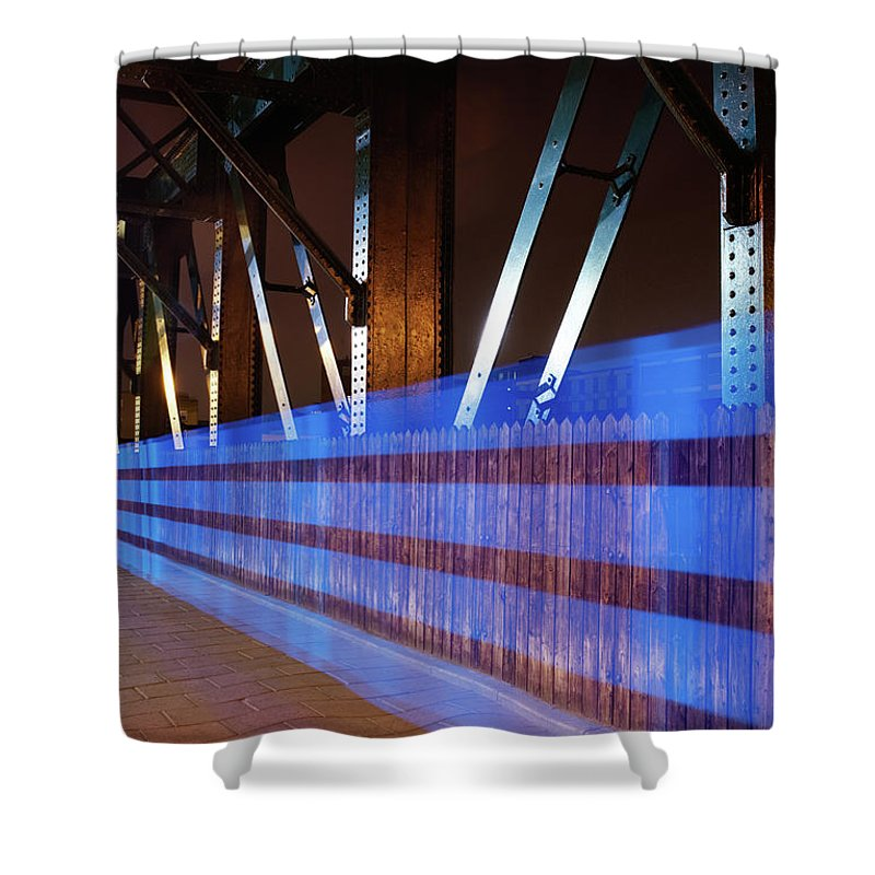 Internet Shower Curtain featuring the photograph Blue Light Trail On Bridge by Tim Robberts