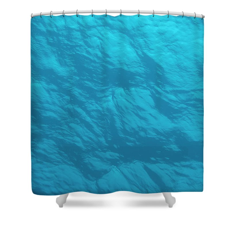 Tranquility Shower Curtain featuring the photograph Blue Ocean Water Surface As Seen From by Jeff Hunter