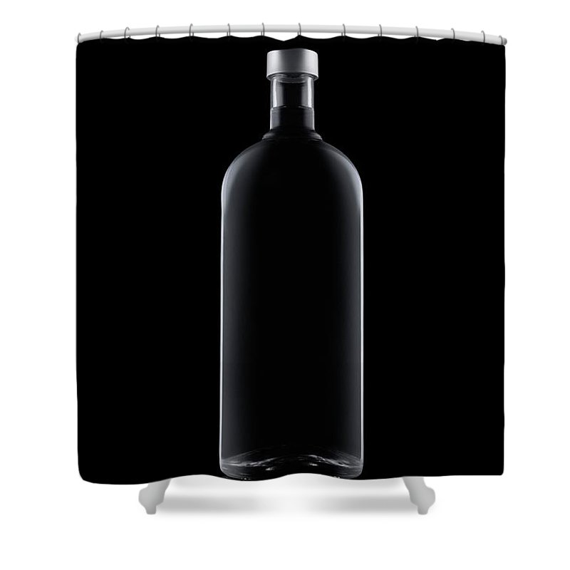 Black Color Shower Curtain featuring the photograph Bottle Of Water Isolated On Black by Kedsanee
