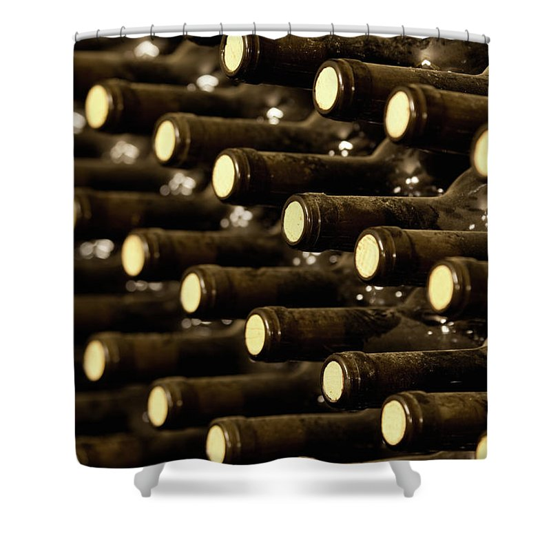 Stellenbosch Shower Curtain featuring the photograph Bottled Red Wine Aging In Wine Cellar by Siegfried Layda
