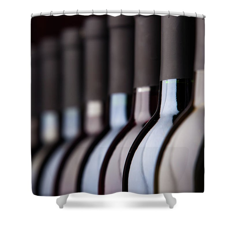 Alcohol Shower Curtain featuring the photograph Bottles Of Wine In A Row by Halbergman