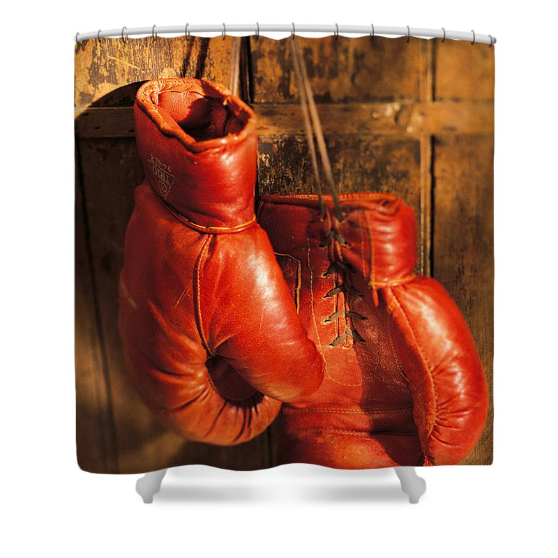 Hanging Shower Curtain featuring the photograph Boxing Gloves Hanging On Rustic Wooden by Comstock