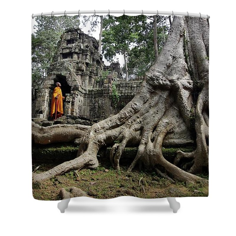 Orange Color Shower Curtain featuring the photograph Buddhist Monk At Angkor Wat Temple by Timothy Allen