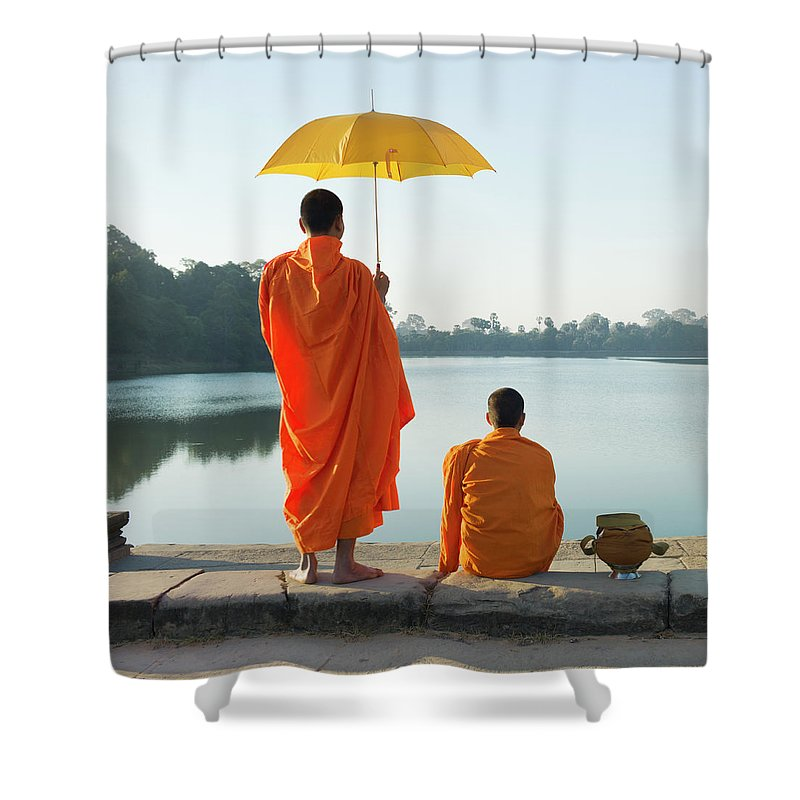 Young Men Shower Curtain featuring the photograph Buddhist Monks Standing In Front Of by Martin Puddy
