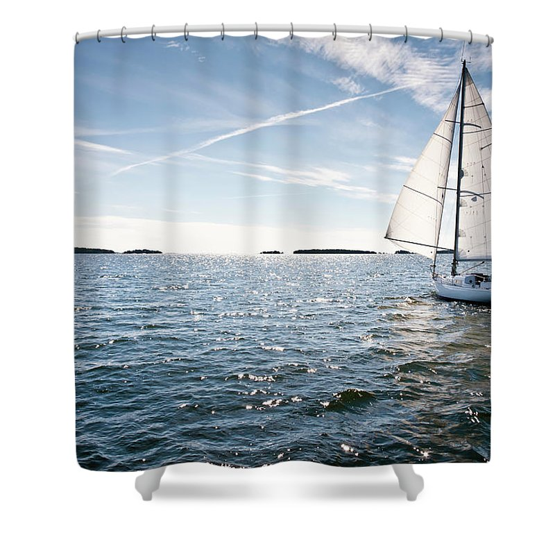 Recreational Pursuit Shower Curtain featuring the photograph Classic Yacht Sailing Away Against Blue by Jaap-willem