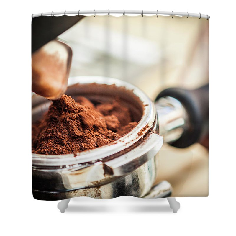 Mature Adult Shower Curtain featuring the photograph Close Up Of Espresso Grounds In Machine by Manuel Sulzer