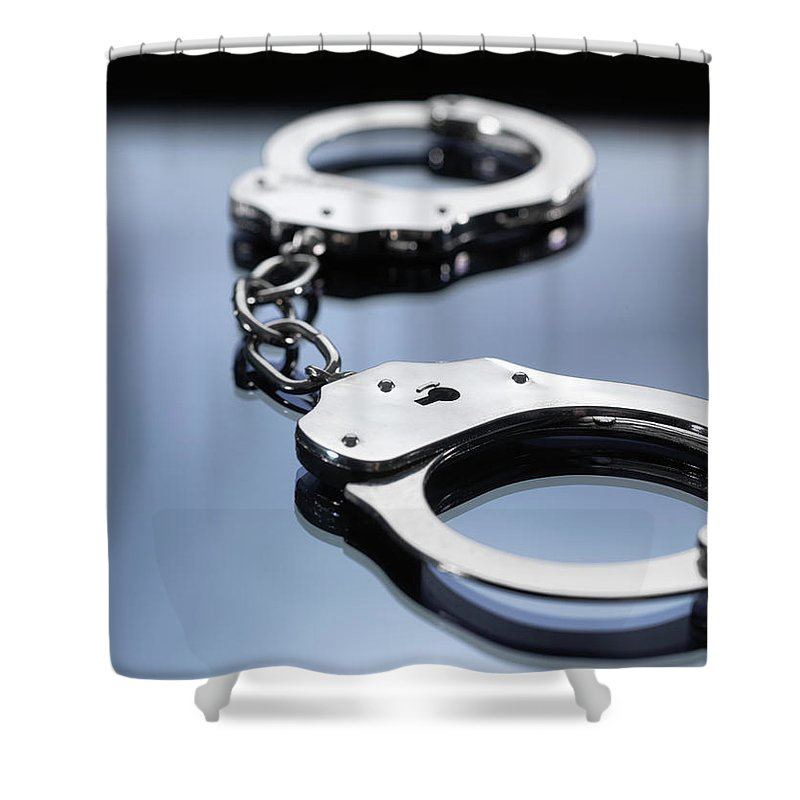 Punishment Shower Curtain featuring the photograph Close Up Of Metal Handcuffs by Andrew Brookes