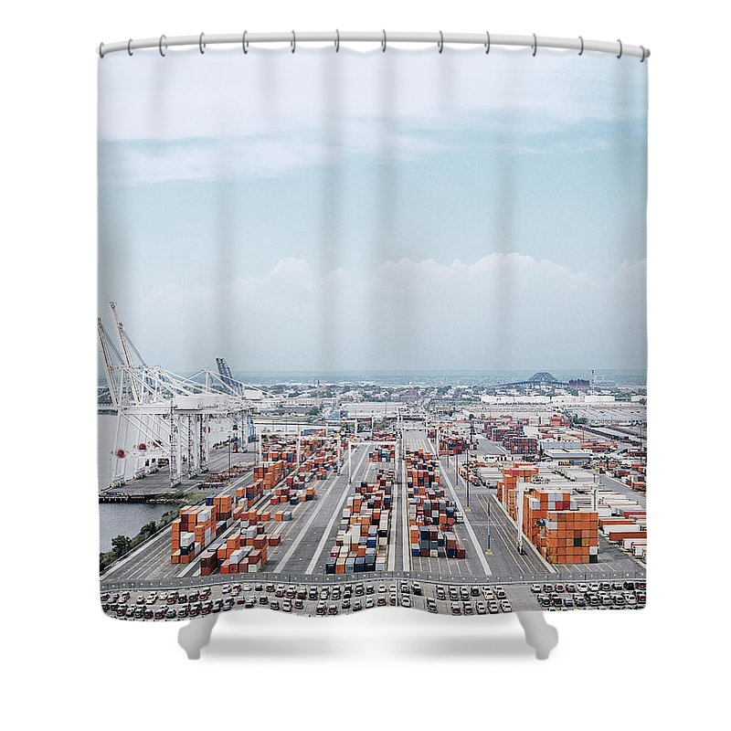 In A Row Shower Curtain featuring the photograph Crane And Cargo Containers On Pier by Erik Von Weber